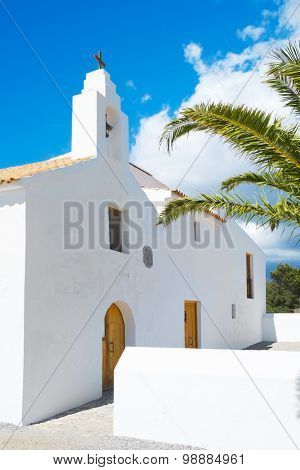 a view of the whitewashed church of Sant Francesc des Estany, built in 1771, in Ibiza Island, Balearic Islands, Spain