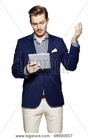 Worried Man Using Digital Tablet
