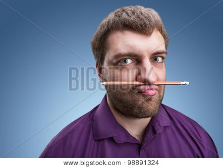 Strange man holds pencil with his nose and lips