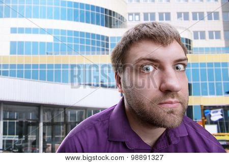 Strange man looks at you