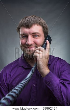 Man speaks on the phone