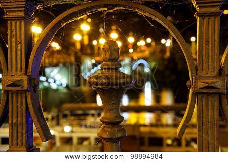 Detail View To Steel Banisters Decoration With Bridge Lights In Background