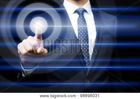 Businessman pressing virtual icons
