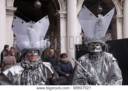 Masked Person In Venetian Costume Attends The Carnival Of Venice