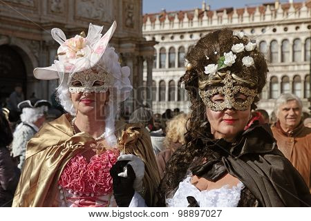 Women In Venetian Carnival Costume Posing At San Marco Square, Carnival Of Venice.