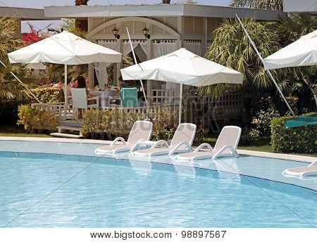 Sun Beds In The Swimming Pool For Relax On Beautiful Summer Resort