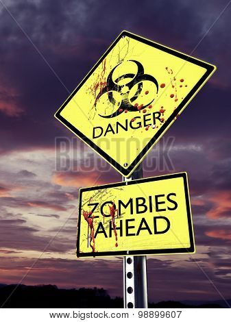 Danger Zombies ahead weathered bio hazard warning sign with blood.