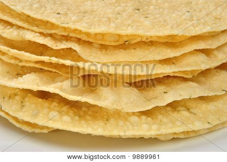 Home Made Indian Poppadoms On A White Plate