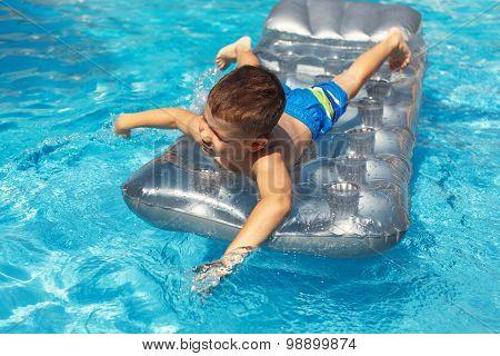 Little Boy Swim On Air Mattress