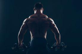 foto of bicep  - Muscle man doing bicep curls - JPG