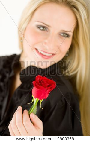 Elegant Woman Hold Red Rose