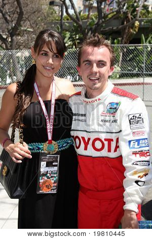 LOS ANGELES - APR 16:  Elycia Turnbow, Frankie Muniz  attend the Toyota Grand Prix Pro Celeb Race at the Toyota Grand Prix Track on April 16, 2011 in Long Beach, CA.
