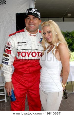 LOS ANGELES - APR 16:  Tito Ortiz, Jenna Jameson  attend the Toyota Grand Prix Pro Celeb Race at the Toyota Grand Prix Track on April 16, 2011 in Long Beach, CA.
