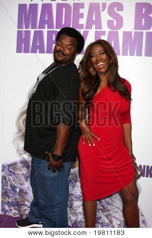 "LOS ANGELES - APR 19:  Craig Robinson, Kenya Moore arrive at the ""Madea's Big Happy Family"" Premiere at ArcLight Cinemas Cinerama Dome on April 19, 2011 in Los Angeles, CA.."