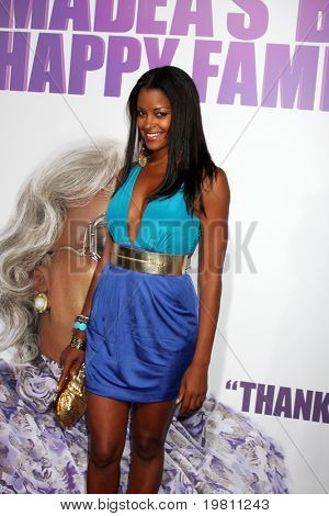 "LOS ANGELES - APR 19:  Claudia Jordan arrives at the ""Madea's Big Happy Family"" Premiere at ArcLight Cinemas Cinerama Dome on April 19, 2011 in Los Angeles, CA.."