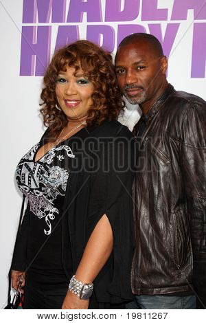 "LOS ANGELES - APR 19:  Kym Whitley, Rodney Van Johnson arrive at the ""Madea's Big Happy Family"" Premiere at ArcLight Cinemas Cinerama Dome on April 19, 2011 in Los Angeles, CA.."