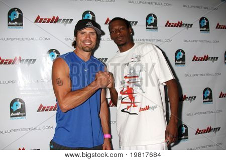 LOS ANGELES - MAY 1:  Joshua Morrow, Jamal Nelson arriving at the 1st Annual Ball Up Celebrity Streetball Game at Cal State Northridge's Matadome Stadium on May 1, 2011 in Northridge, CA