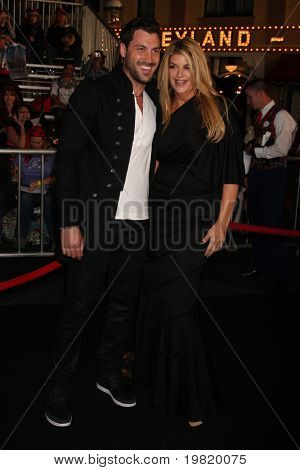 """LOS ANGELES - MAY 7:  Maksim Chmerkovskiy, Kirstie Alley arriving at the """"Pirates of The Caribbean: On Stranger Tides"""" World Premiere at Disneyland on May 7, 2011 in Anaheim, CA"""