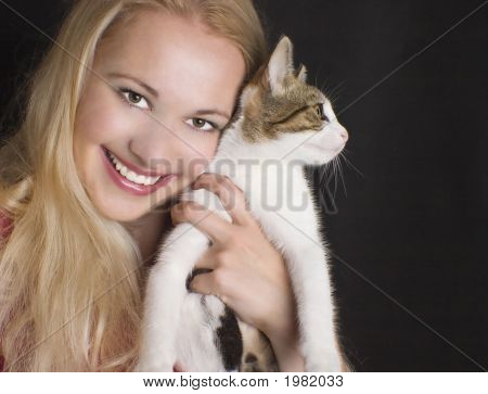 Smiling Woman With Young Cat.
