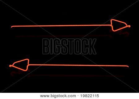 Red arrows on a black background.
