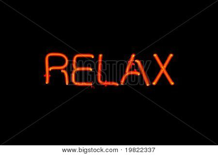 Red neon sign of the word 'Relax' on a black background.