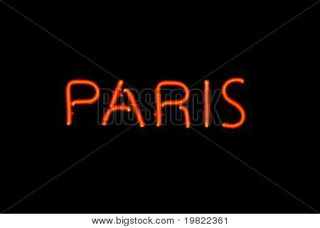 Red neon sign of the word 'Paris' on a black background.