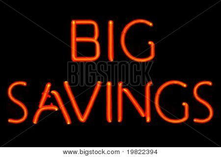 Red neon sign of the words 'Big Savings' on a black background.