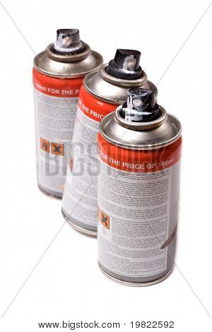 Spraypaint aerosol cans isolated on a white background.