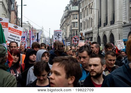 PICCADILLY, LONDON - MARCH 26: Demonstrators march along Piccadilly during protests against public sector funding cuts in central London on 26th March 2011.