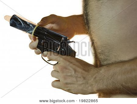 Cropped shot of a male hand holding a .38 calibre with a condom on it and hairy chest from the side. White background.