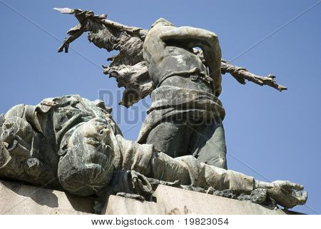 Cropped low angle shot of war memorial statue in Bologna, Italy.