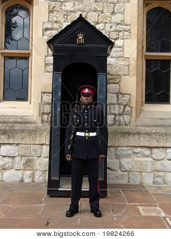 Guard with sentry box at Tower of London in England