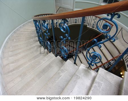 Ornate stairs and banisters on spiral staircase in Somerset House, London