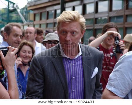 WIMBLEDON, ENGLAND - JUNE 24: Former tennis champion Boris Becker walks through the crowds at Wimbledon lawn Tennis Championship at Wimbledon, England on June 24, 2010.