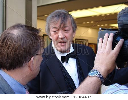 REGENT STREET, LONDON - MAY 11: Stephen Fry the actor and TV presenter being interviewed at a product launch in Regent Street, London on May 11, 2010. Stephen Fry is a famous TV presenter and actor.
