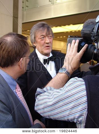 REGENT STREET, LONDON - MAY 11: Stephen Fry the famous actor being interviewed at product launch in Regent Street, London on May 11, 2009. Stephen Fry is an actor and TV presenter.