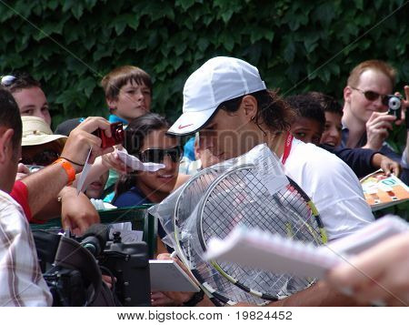 WIMBLEDON, ENGLAND - JUNE 24: Rapha Nadal signing autographs at the Wimbledon Lawn Tennis Championship in Wimbledon, England on June 24, 2010. Rapha Nadal went on to win the championship