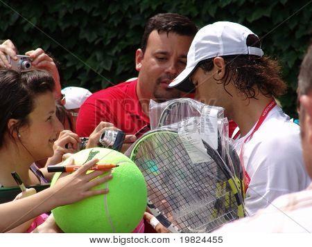 WIMBLEDON, ENGLAND - JUNE 24: Rapha Nadal meeting fans at the Wimbledon Lawn Tennis Tournament in Wimbledon, England on June 24, 2010. Rapha Nadal went on to win the tournament at Wimbledon.