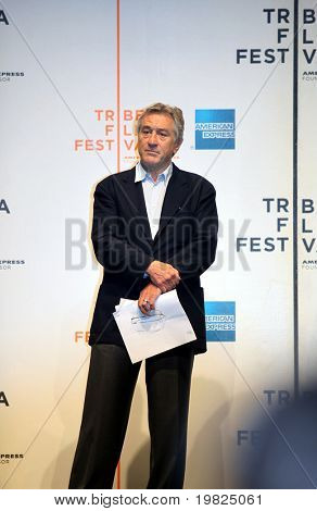 NEW YORK - APRIL 21 : Actor Robert De Niro listens to speeches at Tribeca Film Festival opening April 21, 2009 in New York. The festival was founded in 2002 by Jane Rosenthal and Robert De Niro
