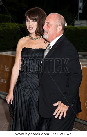 NEW YORK - SEPTEMBER 21: Deborah Dampiere and Billy Joel attends the Metropolitan Opera 2009-10 season opening with a performance of 'Tosca' at Lincoln Center on September 21, 2009 in New York City.