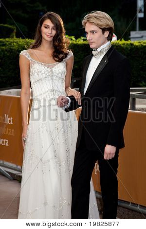 NEW YORK - SEPTEMBER 21: Austin Scarlett and a guest attend the Metropolitan Opera 2009-10 season opening night at Lincoln Center for the Performing Arts on September 21, 2009 in New York City.