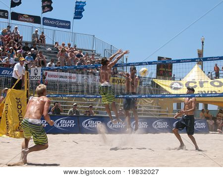 HUNTINGTON BEACH, CA. - MAY 23: Ty Loomis and Casey Patterson vs. Phil Daulhausser and Todd Rogers at the AVP Huntington Beach Open on the weekend May 23, 2009 in Huntington Beach, California.