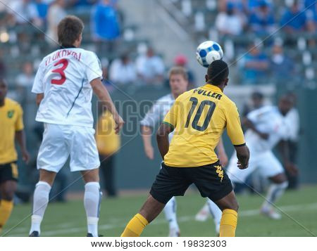 CARSON, CA. - JULY 3: Concacaf Gold Cup soccer match, Canada vs. Jamaica at the Home Depot center in Carson. Ricardo Fuller in position to head the ball with Michael Klukowski to his left on July 3, 2009.