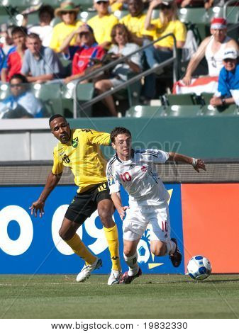 CARSON, CA. - JULY 3: Concacaf Gold Cup soccer match, Canada vs. Jamaica at the Home Depot center in Carson. Ricardo Fuller and William Johnson fighting for the ball on July 3, 2009.