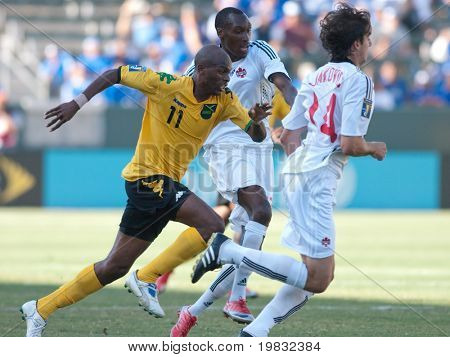 CARSON, CA. - JULY 3: Concacaf Gold Cup soccer match, Canada vs. Jamaica at the Home Depot center in Carson. Luton Shelton, Dejan Jakovic, and Atiba Hutchinson fight for the ball on July 3, 2009.