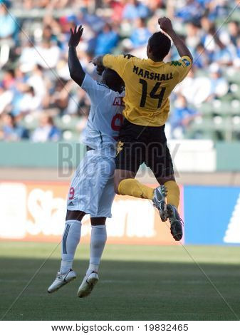 CARSON, CA. - JULY 3: Concacaf Gold Cup soccer match, Canada vs. Jamaica at the Home Depot center in Carson. Tyrone Marshall and Ali Gerba jump for the ball on July 3, 2009.