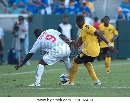 CARSON, CA. - JULY 3: Concacaf Gold Cup soccer match, Canada vs. Jamaica at the Home Depot center in Carson. Claude Davis defending as Ali Gerba maneuvers around with the ball on July 3, 2009.