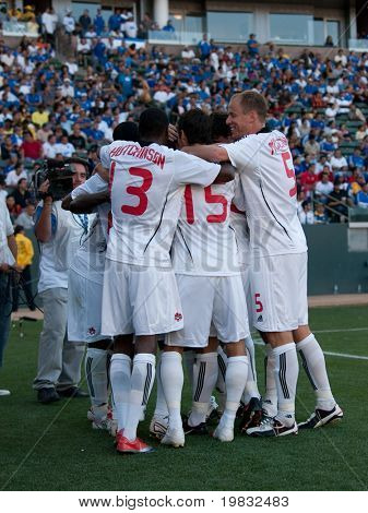 CARSON, CA. - JULY 3: Concacaf Gold Cup soccer match, Canada vs. Jamaica at the Home Depot center in Carson. Canadian team celebrates after Ali Gerba scored the winning goal in the 75th minute on July 3, 2009.