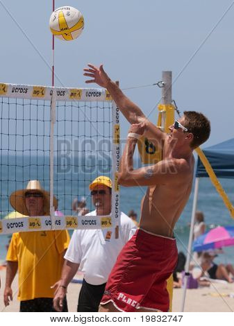 MANHATTAN BEACH, CA. - JULY 18: Mike Placek getting the ball over the net at the AVP Manhattan Beach Open on July 18, 2009 in Manhattan Beach, CA.