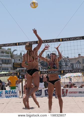 MANHATTAN BEACH, CA. - JULY 18: Chelsea Hayes spikes and Jenny Kropp attempting to block at the AVP Manhattan Beach Open on July 18th 2009